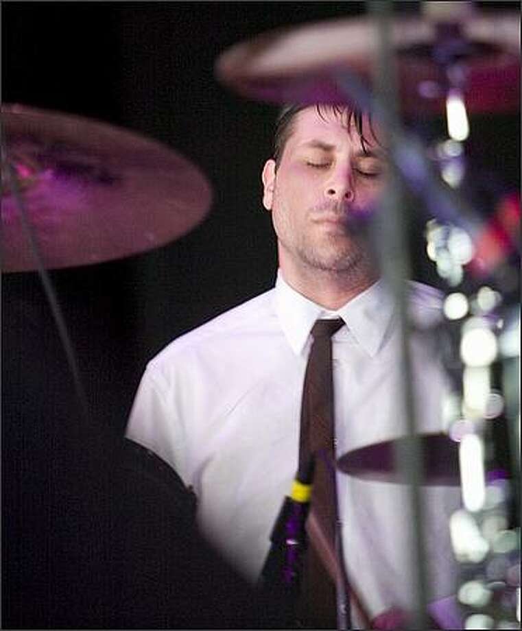 The Liars drummer Julian Gross feels the beat as they were the opening act for Radiohead at White River Amphitheatre. Photo: Grant M. Haller, Seattle Post-Intelligencer