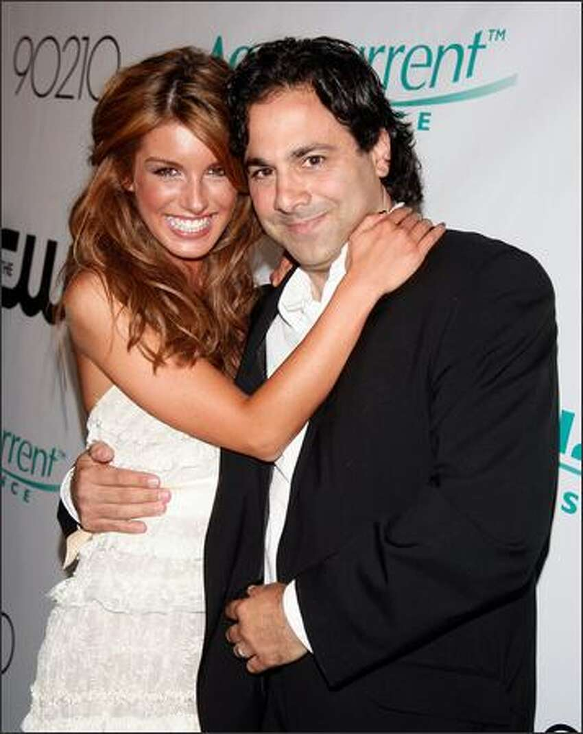 Actress Shenae Grimes, left, and producer Gabe Sachs arrive at the premiere party for the CW Network's