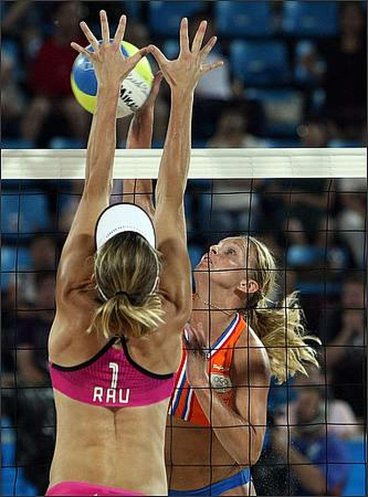 Germany's Okka Rau (L) blocks a smash from Dutch Rebekka Kadijk during their Women's preliminary beach volleyball match of the 2008 Beijing Olympic Games at Beijing's Chaoyang Park Beach Volleyball Ground. Germany won 2-1. (Photo THOMAS COEX/AFP/Getty Images)