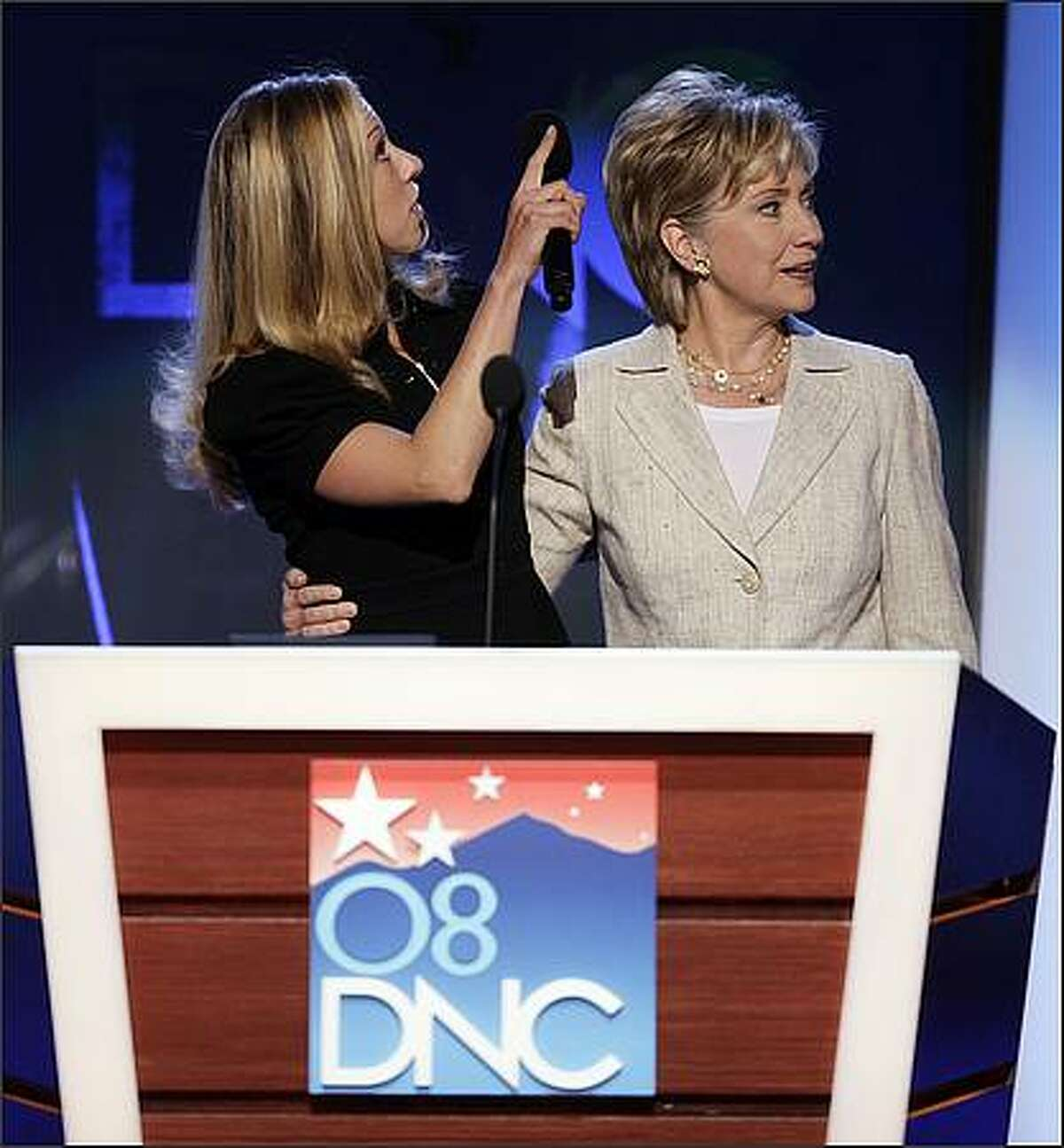 Sen. Hillary Rodham Clinton, D-N.Y., right, tours the podium with her daughter, Chelsea, at the Democratic National Convention in Denver. (AP Photo/Ron Edmonds)