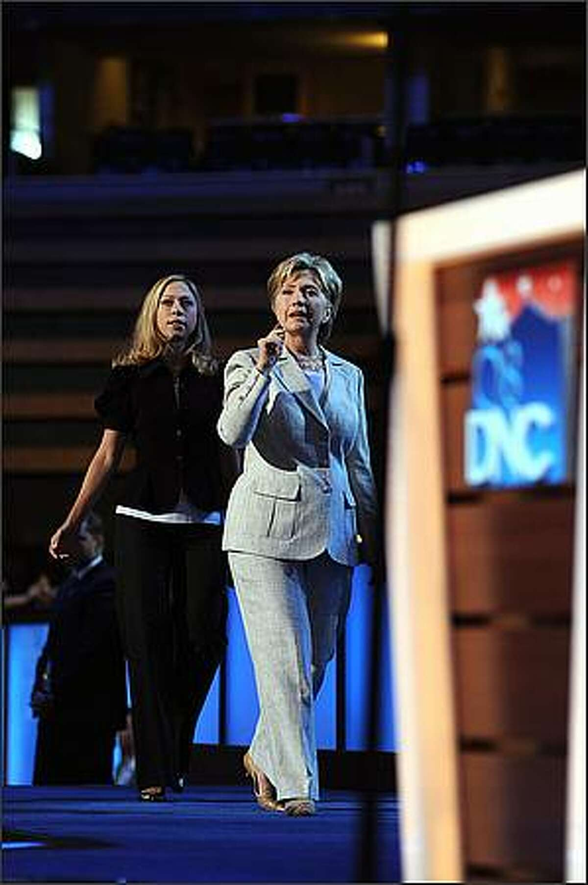 Sen. Hillary Rodham Clinton (D-N.Y.) is joined by her daughter, Chelsea Clinton, for a walkthrough and soundcheck for her address to the Democratic National Convention in Denver. (Kevin Moloney/The New York Times)