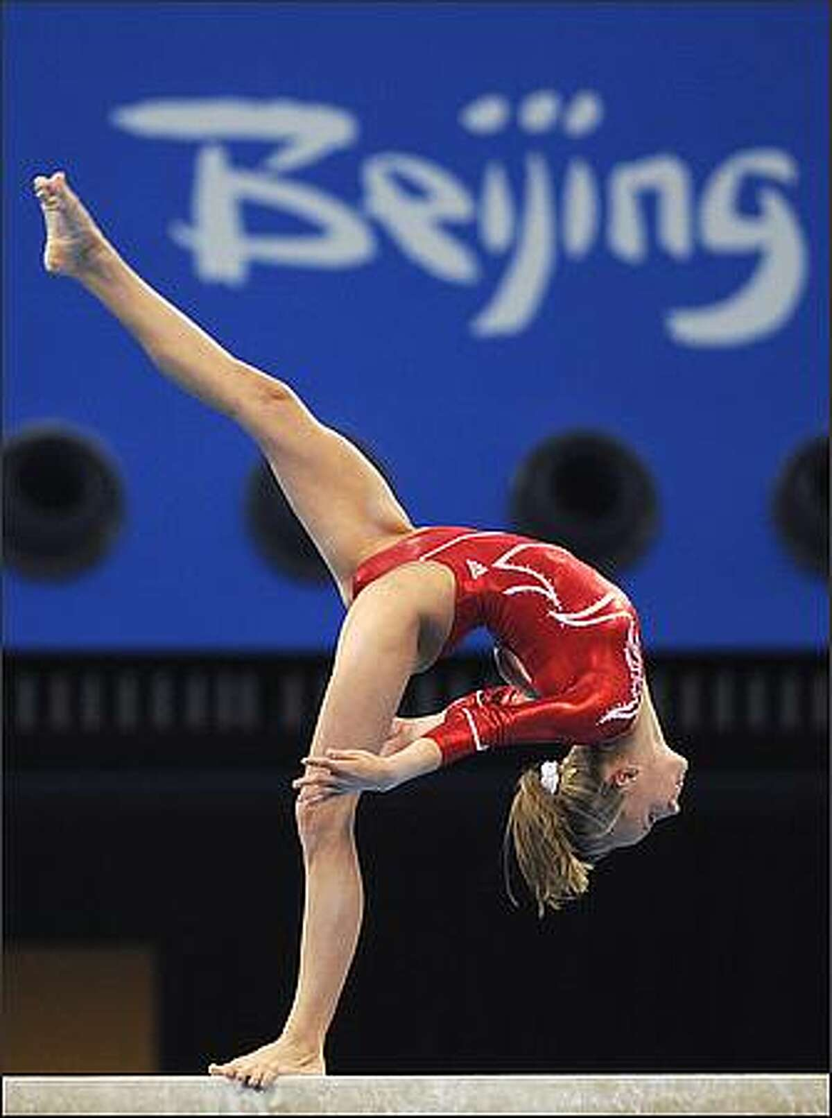 United States' Nastia Liukin competes on the balance beam during the women's team final of the artistic gymnastics event of the Beijing 2008 Olympic Games in Beijing. China won the gold, while United States won the silver and Romania the bronze. (Photo FRANCK FIFE/AFP/Getty Images)
