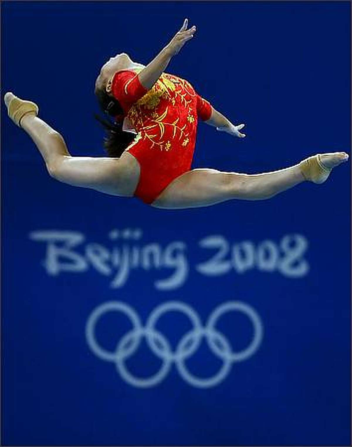 Li Shanshan of China performs on the balance beam during the women's team final of the artistic gymnastics event at the National Indoor Stadium during Day 5 of the Beijing 2008 Olympic Games in Beijing, China. (Photo by Shaun Botterill/Getty Images)