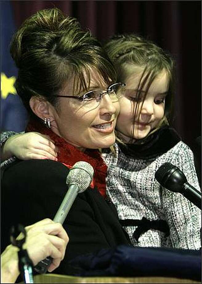 In this Nov. 8, 2006 file photo, then Governor-elect Sarah Palin holds her daughter Piper as she gives a victory speech in Anchorage, Alaska. John McCain tapped little-known Alaska Gov. AP Photo/Al Grillo