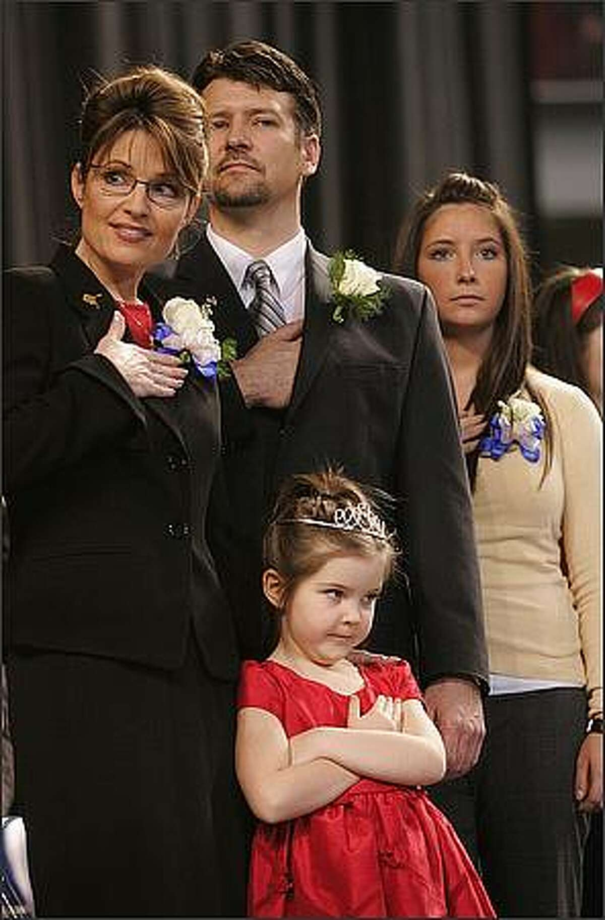 In this Dec. 4, 2006 file photo, Gov. Sarah Palin, left, her husband Todd, and daughters Bristol,16, right, and Piper, 5, front stand as the colors are retired at the end of an inauguration ceremony in Fairbanks, Alaska Palin, 42, is the first female and youngest governor of Alaska. AP Photo/Al Grillo