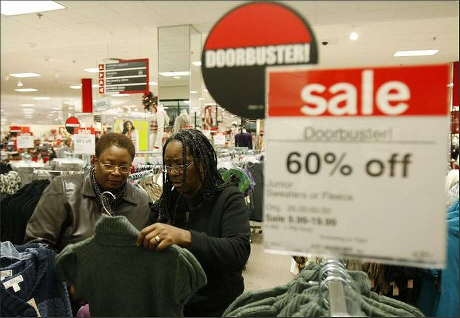 Brenetta Ward, left, and Zinda Foster shop at JC Penney in the Northgate Mall on Black Friday. Photo: Brad Vest/Seattle Post-Intelligencer
