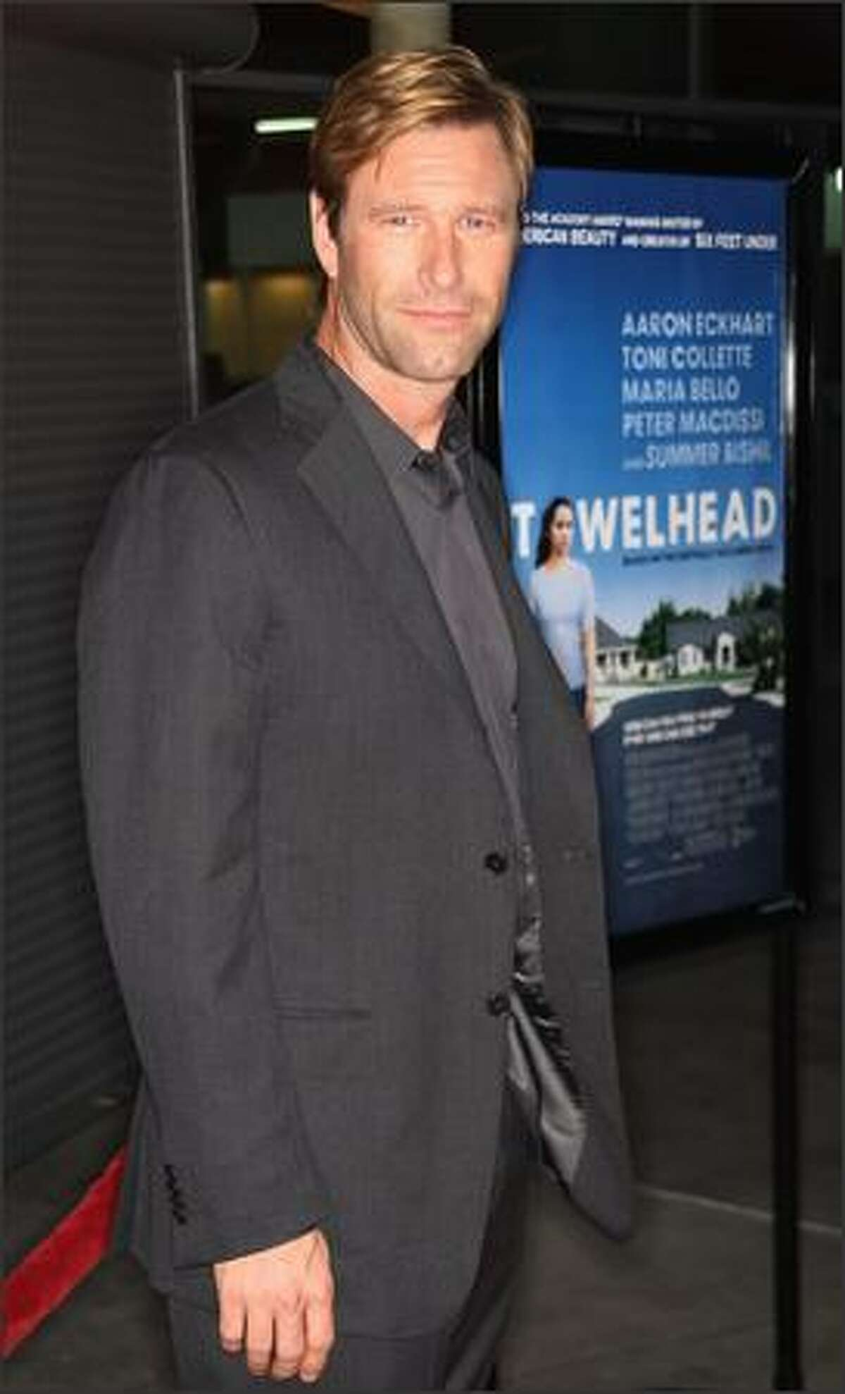 Actor Aaron Eckhart attends the