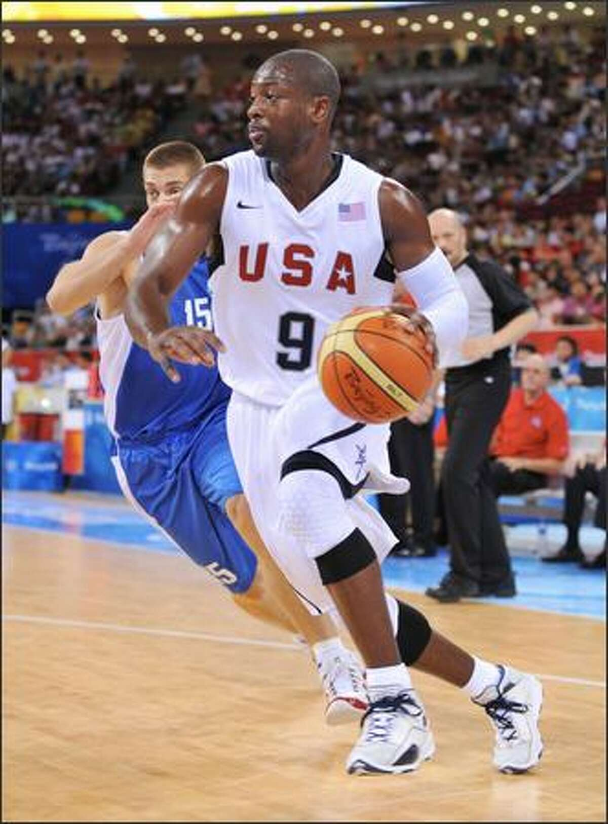 Dwyane Wade #9 of the U.S. Men's Senior National Team drives against Michalis Pelekanos #15 of Greece during a men's preliminary basketball game at the 2008 Beijing Olympic Games at the Beijing Olympic Basketball gymnasium on Thursday in Beijing, China. The U.S. won 92-69.