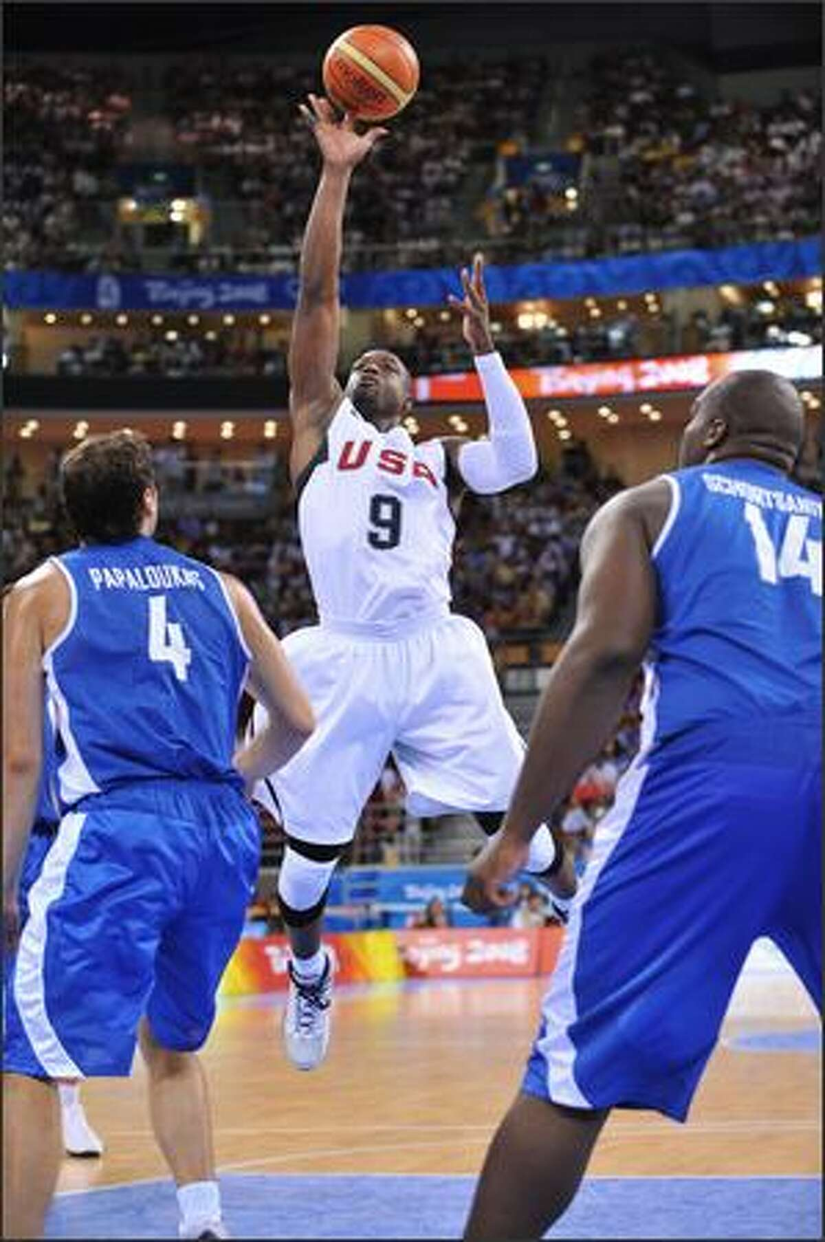 Dwyane Wade #9 of the U.S. Men's Senior National Team shoots against Theo Papaloukas #4 of Greece during a men's preliminary basketball game at the 2008 Beijing Olympic Games at the Beijing Olympic Basketball gymnasium on Thursday in Beijing, China.