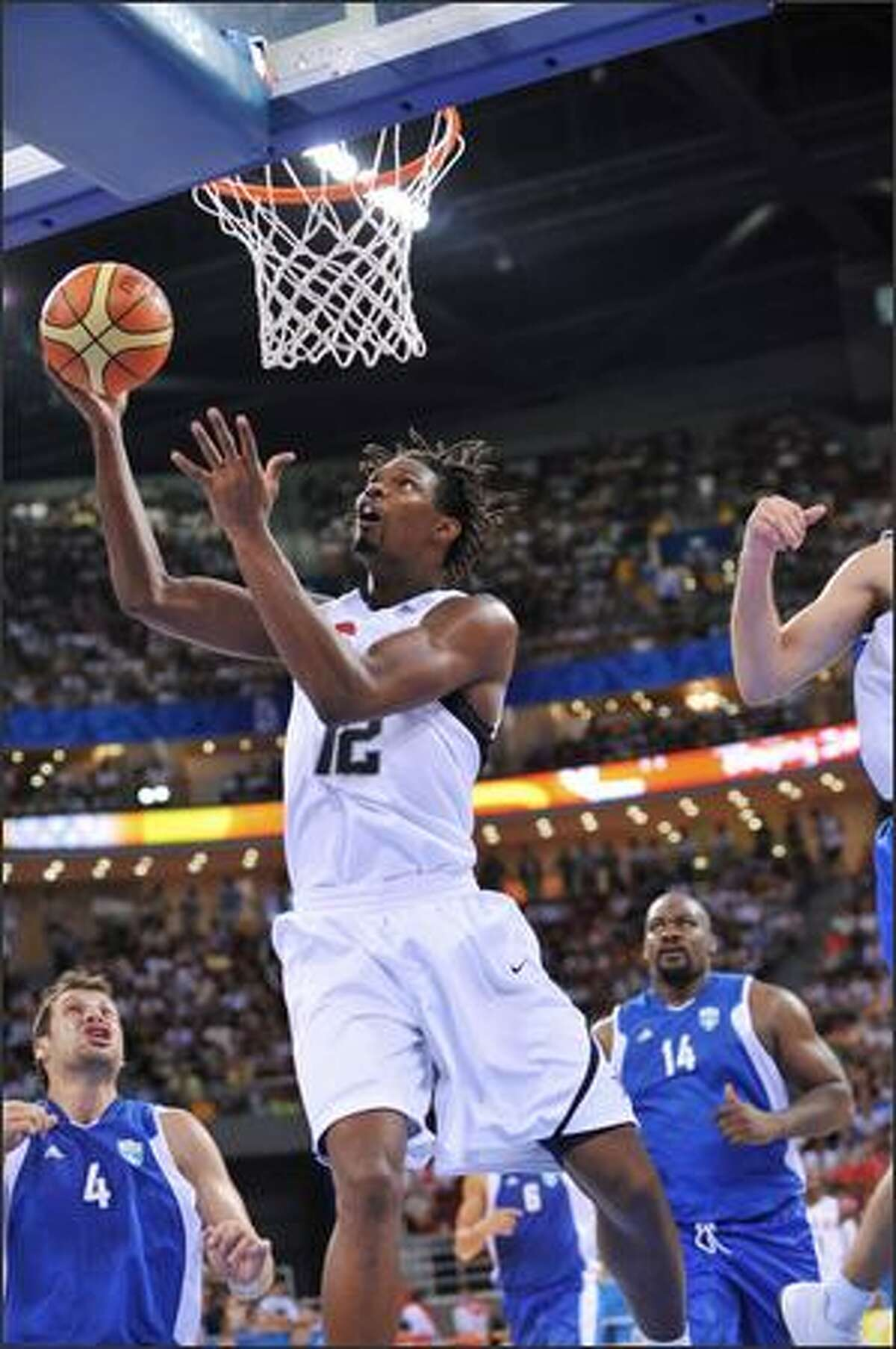 Chris Bosh #12 of the U.S. Men's Senior National Team shoots against Greece during a men's preliminary basketball game at the 2008 Beijing Olympic Games at the Beijing Olympic Basketball gymnasium on Thursday in Beijing, China.