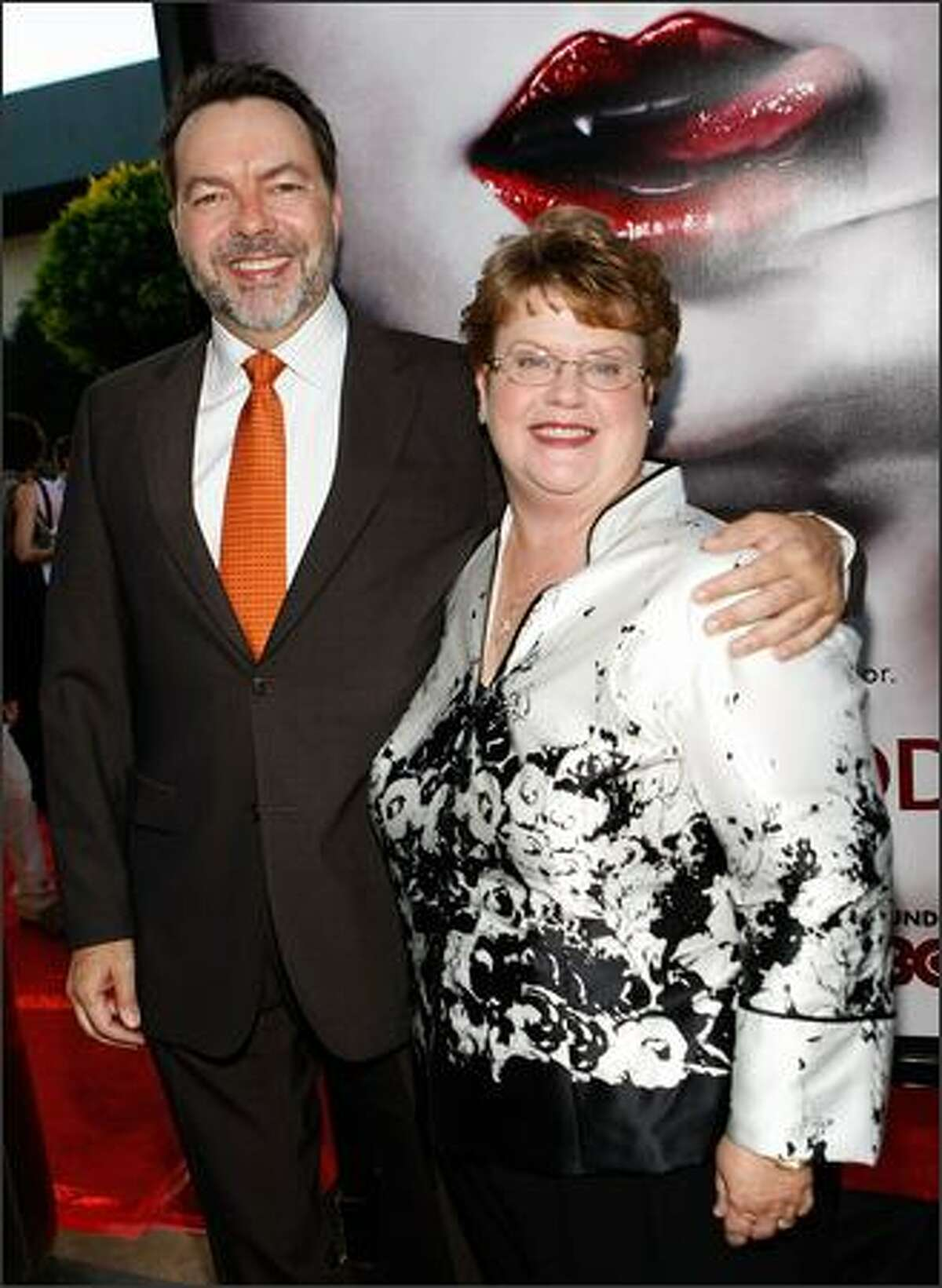 """Producer Alan Ball (L) and writer Charlaine Harris arrive at the Los Angeles premiere of HBO's series """"True Blood"""" at the Cinerama Dome on Thursday in Hollywood, Calif."""