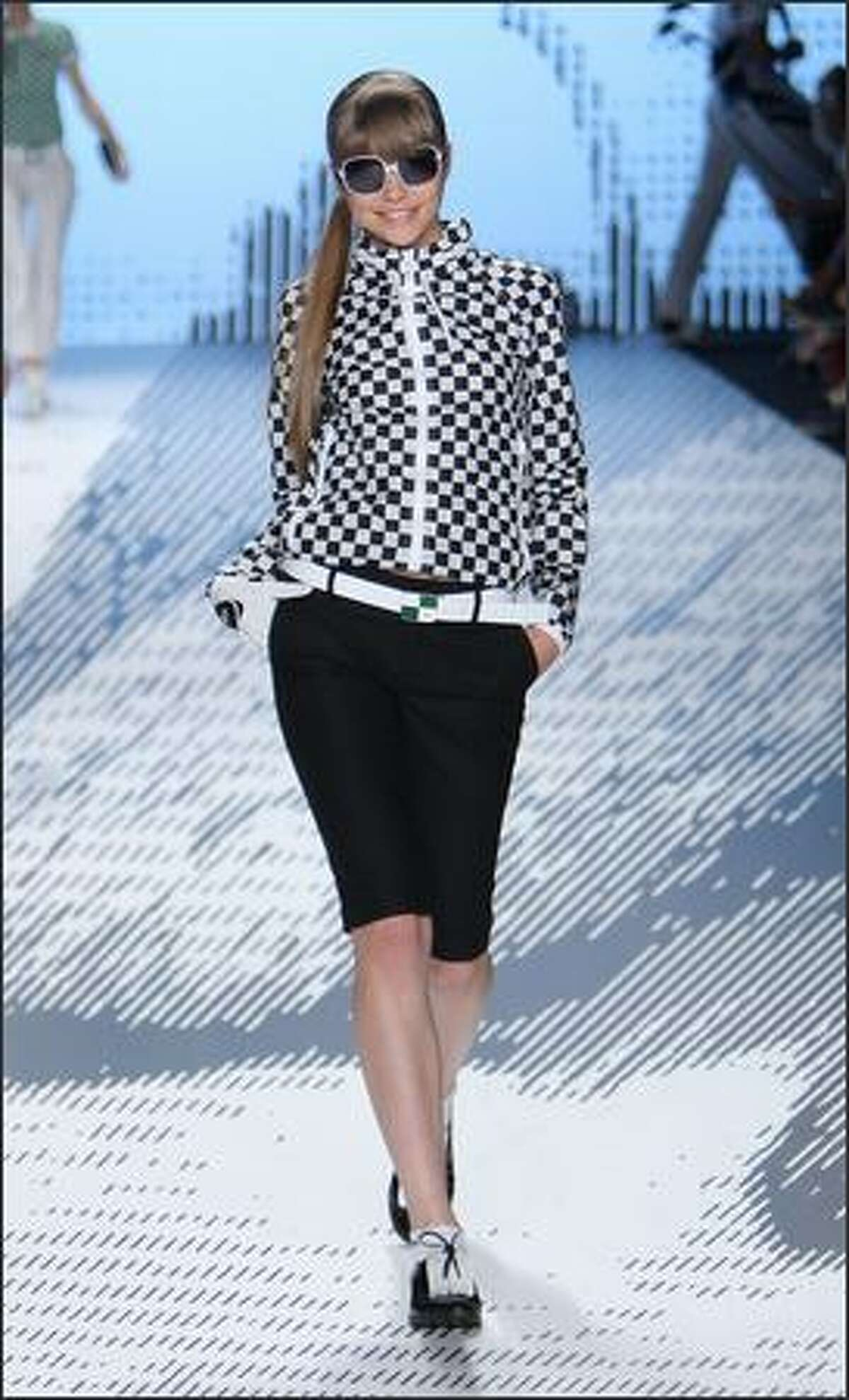 A model walks the runway during the Lacoste show.