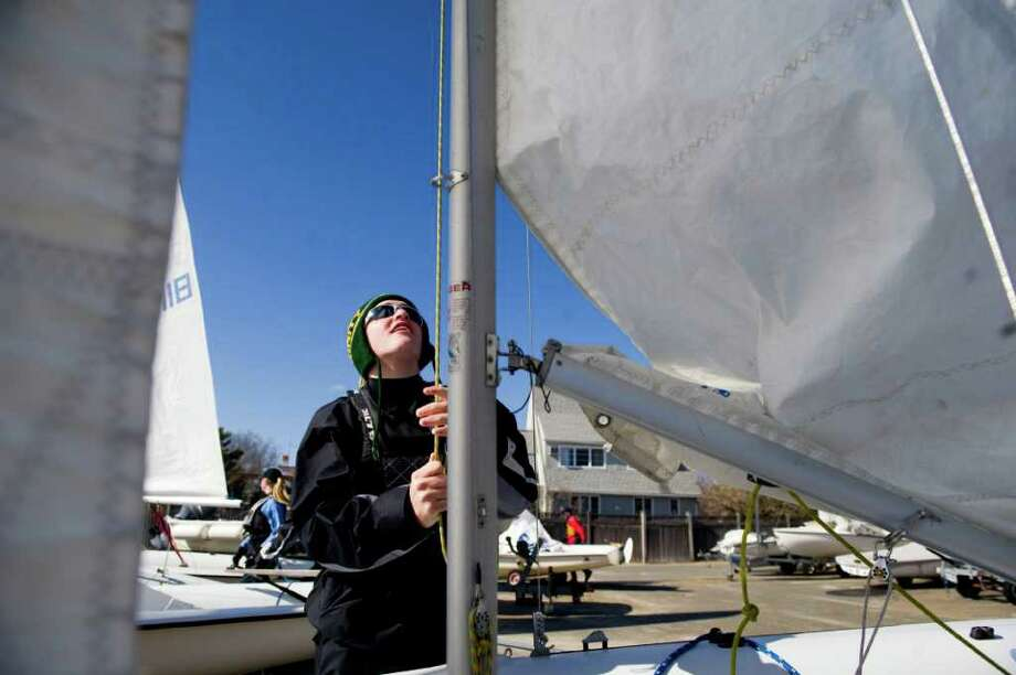 Johnny Shanahan makes some adjustments as he prepares to sail during practice with the Stamford Schools Sail Team at Stamford Yacht Club in Stamford, Conn., March 23, 2011. The Board of Education recently approved Stamford's first youth sailing team, the intramural team is run by the Stamford Youth Foundation. Photo: Keelin Daly / Stamford Advocate