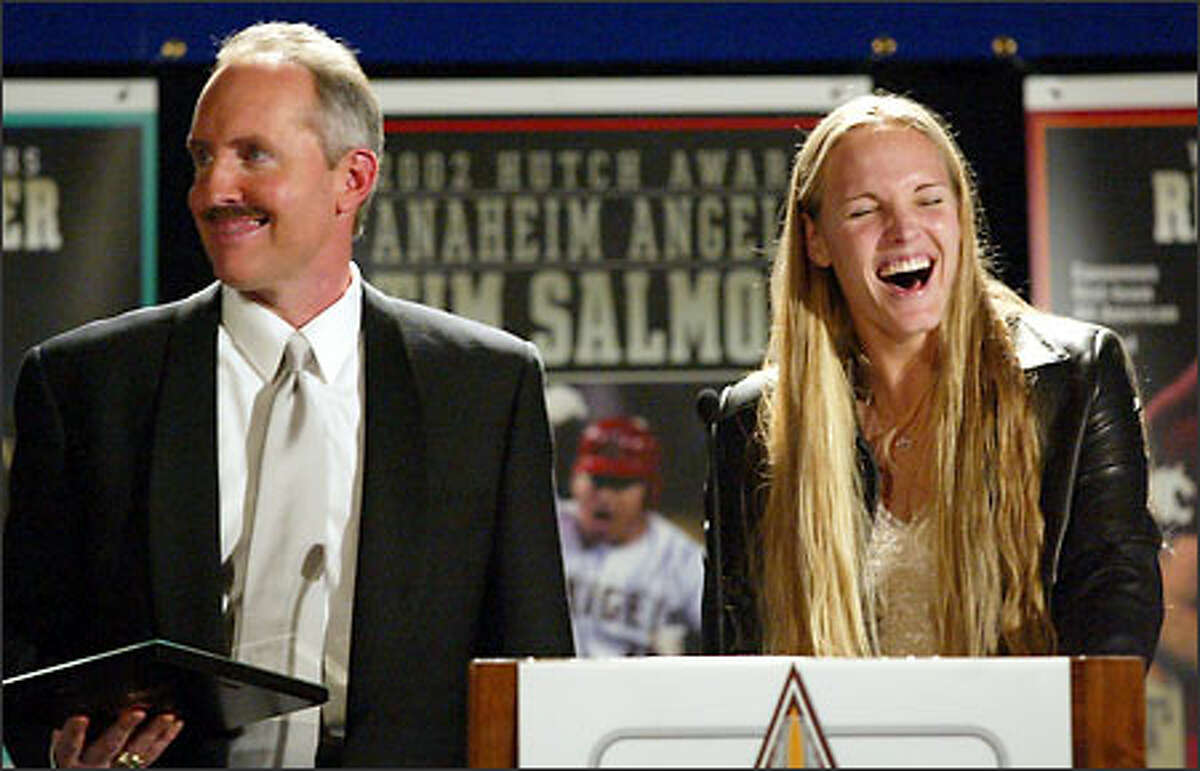 Banquet Emcee Steve Rable ribs UW softball player Jaime Clark at the 68th Annual Sports Star of the Year Awards.