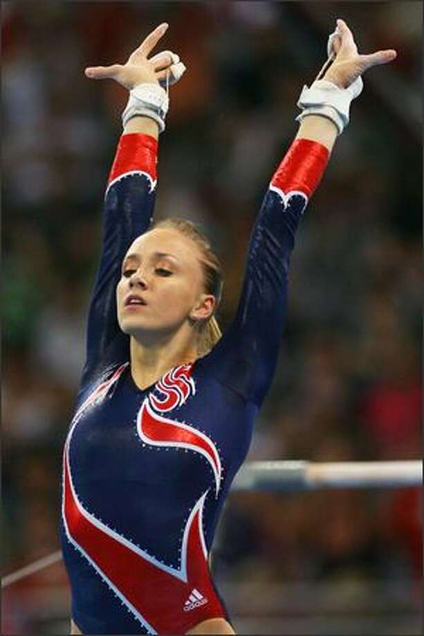 Nastia Liukin of the United States competes in the women's uneven bars final during the artistic gymnastics at the National Indoor Stadium event on Day 10 of the Beijing 2008 Olympic Games on Monday. Photo: Getty Images