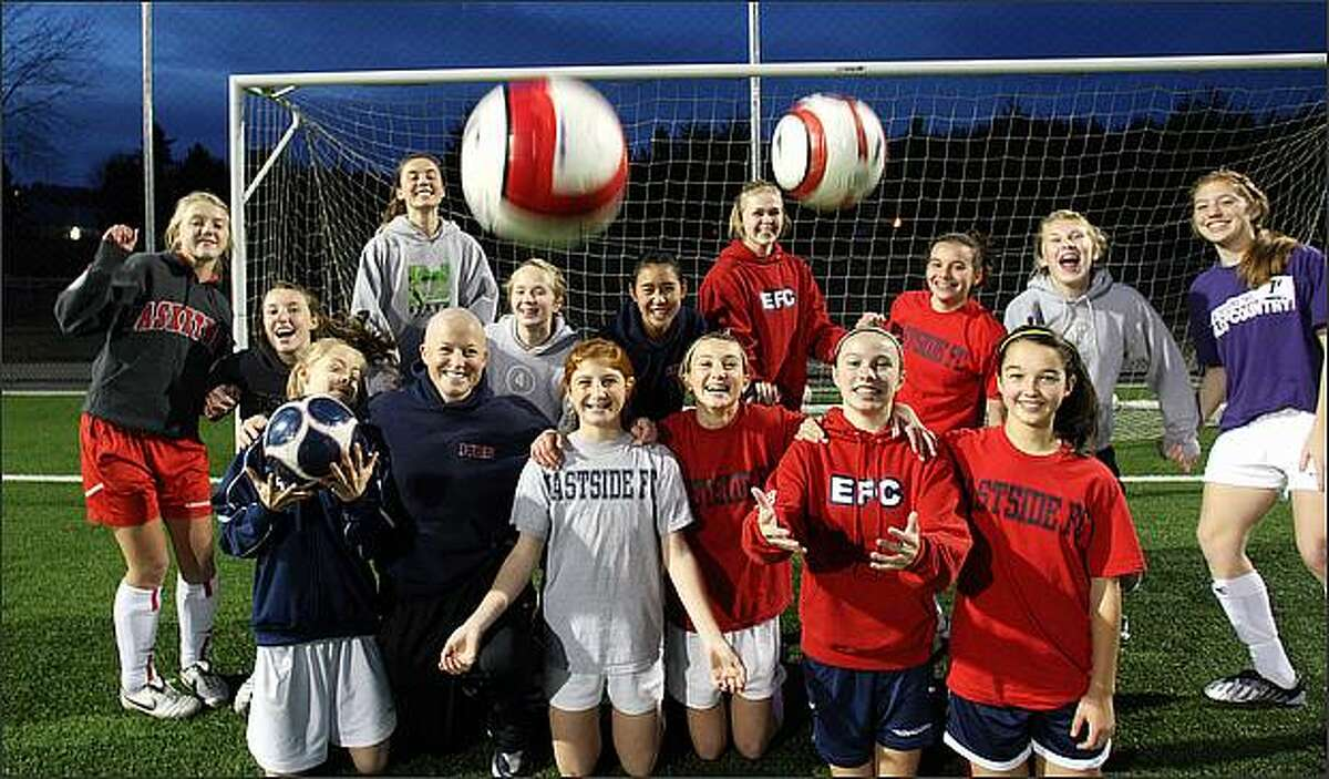 As she fights non-Hodgkin's lymphoma, Michelle French, 31, the state's second-most-decorated women's soccer player, is back to coaching her three soccer teams, including the Girls' Under 14 Eastside Football Club Red team in Preston. French, second from left in the bottom row, is undergoing chemotherapy and has a 90 percent chance of recovery.