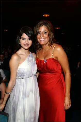 Actress Selena Gomez (L) and NCLR board member Andrea Bazan in the audience during the 2008 ALMA Awards at the Pasadena Civic Auditorium on Sunday in Pasadena, Calif. Photo: Getty Images