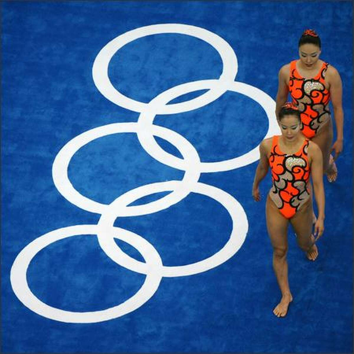 Japanese Saho Harada, front, and Emiko Suzuki perform during their synchronized swimming duet technical routine during the 2008 Beijing Olympic Games on Monday.