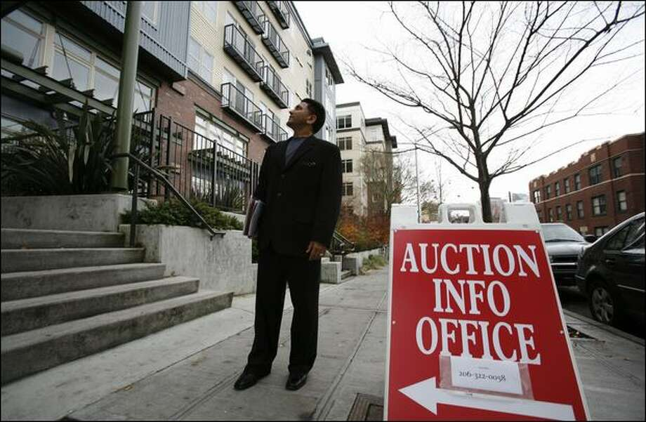 Jessie Cheema went to Capitol Hill on Monday to inspect the Press buildings' condominium units, which will be auctioned in about two weeks. Photo: Paul Joseph Brown/Seattle Post-Intelligencer