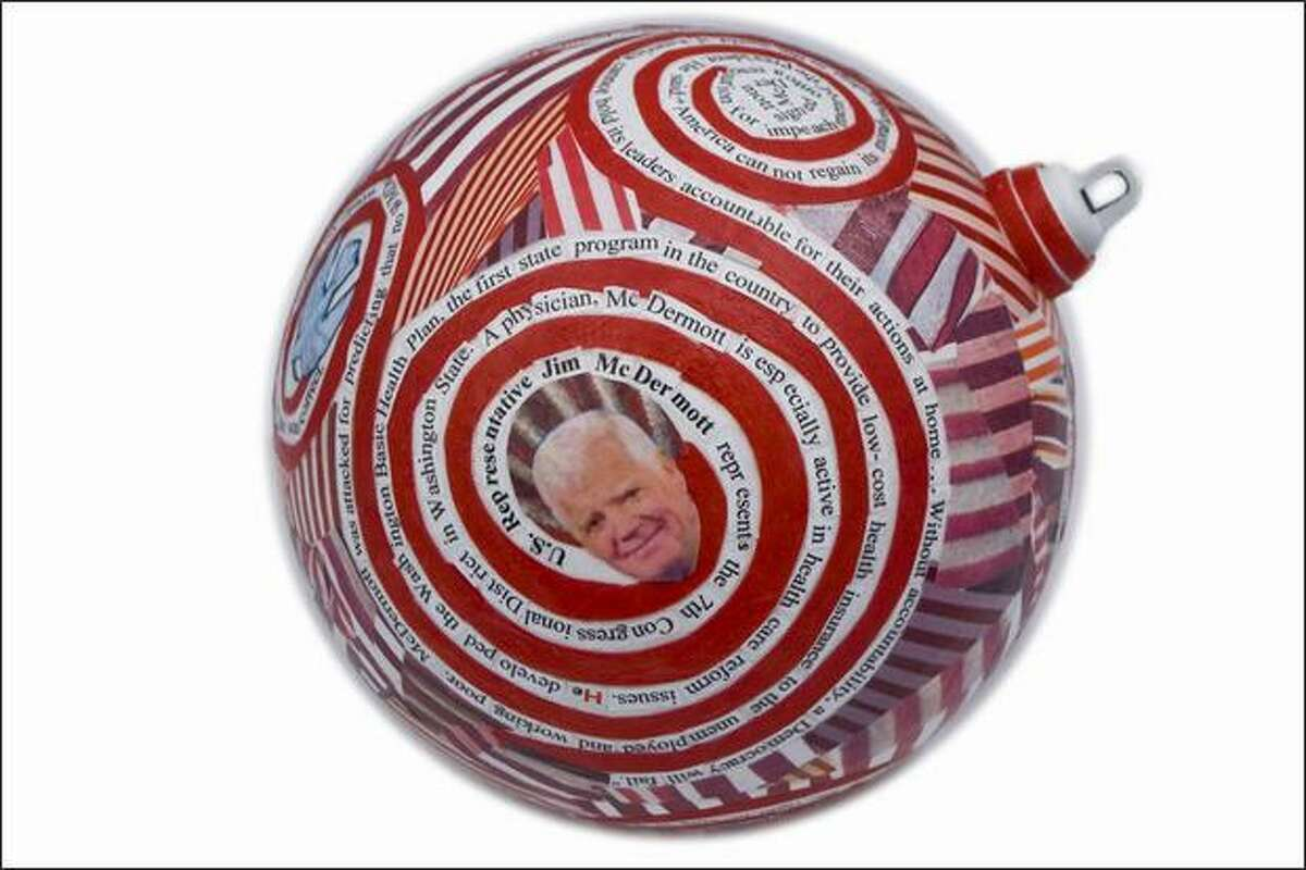 Artist Deborah Lawrence's ornament, which will not hang on the White House Christmas tree. Lawrence said that in creating the bulb, she wanted to salute Democratic Rep. Jim McDermott of Seattle, a longtime President Bush foe who backs impeachment. The nine-inch ball Lawrence created features a picture of McDermott, and glued-on text hails the impeachment resolution. (Photo courtesy Deborah Lawrence)