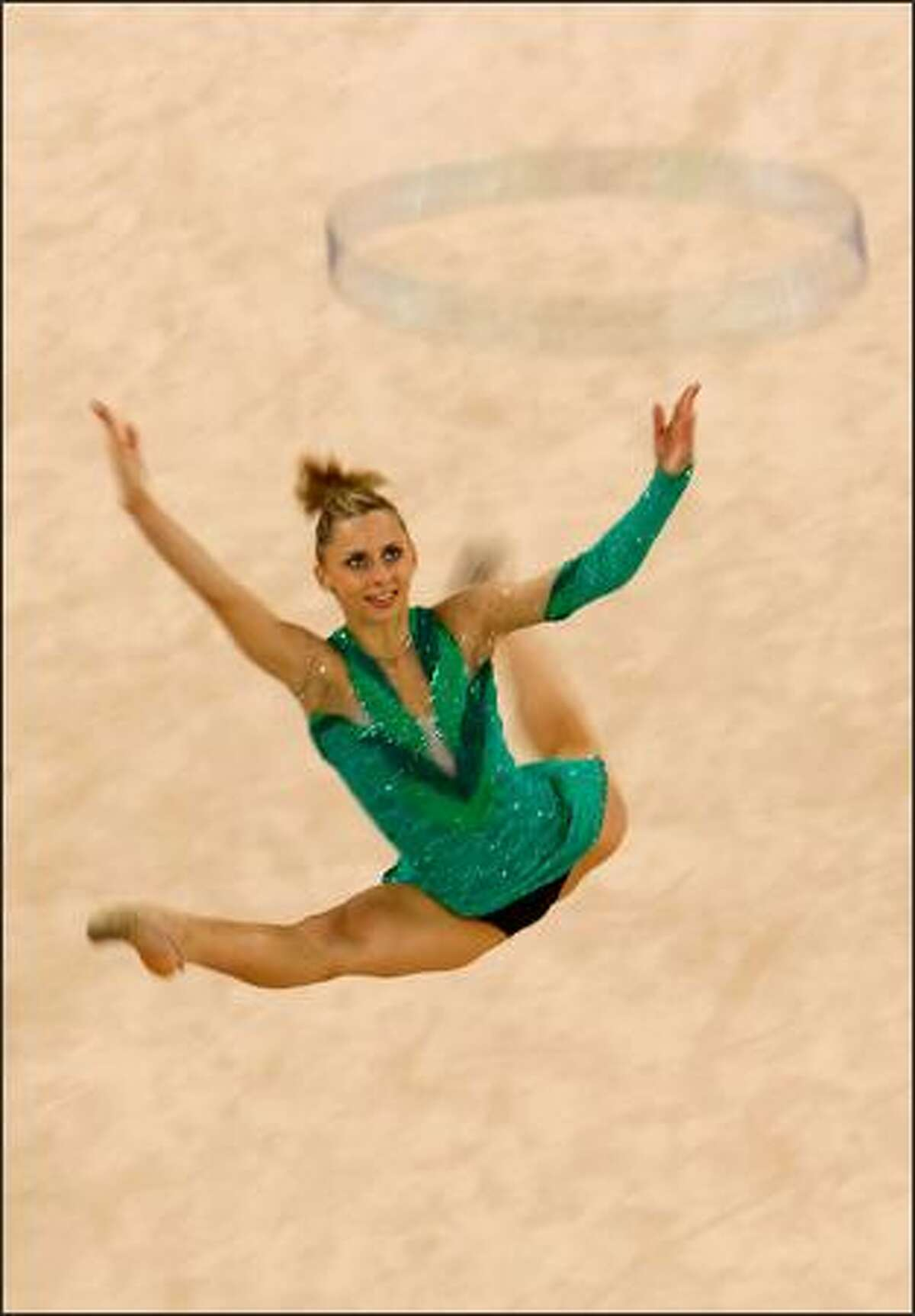 BEIJING - AUGUST 21: Caroline Weber of Austria competes in the Individual All-Around Qualification round held at the Beijing University of Technology Gymnasium during Day 13 of the Beijing 2008 Olympic Games on August 21, 2008 in Beijing, China.