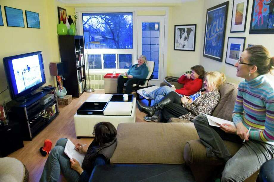 Judges screen best pet video submissions for Outreach to Pets In Need, the Stamford organization dedicated to helping the Stamford animal shelter, at Heather Scutti's home in Stamford, Conn., March 23, 2011. Judges from left, Nadia Cwiach, Jenny Colucci, Heather Craig and Chantel Avignone-O'Neill. Photo: Keelin Daly / Stamford Advocate