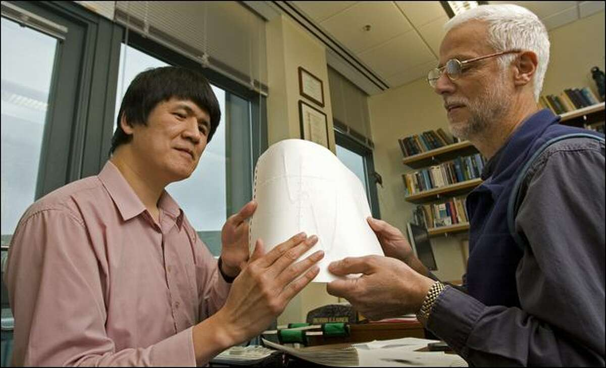 Sangyun Hahn, who is a blind doctoral candidate and an inspiration to UW professor Richard Ladner, looks at a Braille Tactile Graphic of a precalculus fourth-degree equation.