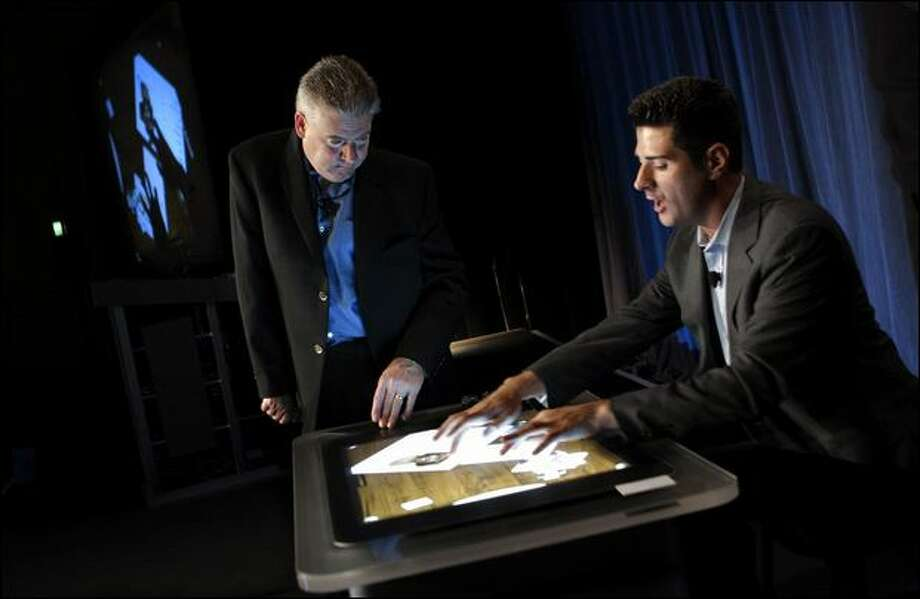 Microsoft's Martin Bean, left, and Anthony Salcito demonstrate technologies that could be used in educational settings during a presentation on Tuesday at the School of the Future World Summit. Photo: Andy Rogers/Seattle Post-Intelligencer