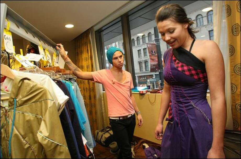 Designer Blayne Walsh checks out a dress worn by model Taylor Mabbott before a dress rehearsal Monday at Hotel 1000. The hotel is kicking off its 12 Days of Comfort, Joy and Cheer holiday promotion with a VIP launch event, fashion show and auction. Photo: Karen Ducey/Seattle Post-Intelligencer