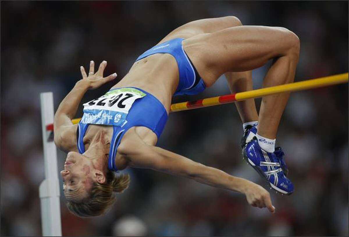 Antonietta di Martino of Italy competes in the women's high jump final at the National stadium as part of the 2008 Beijing Olympic Games on August 23, 2008.
