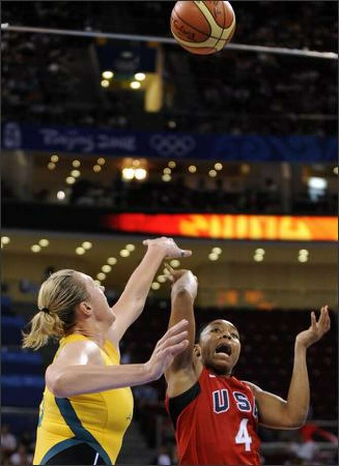 USA's Cappie Pondexter (right) and Australia's Suzy Batkovic jump for the ball. Photo: Getty Images