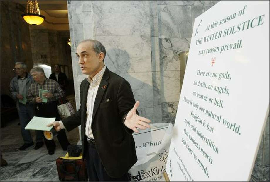 Dan Barker, co-president of the Wisconsin-based Freedom From Religion Foundation, Inc., talks Monday about the sign his organization helped place near a Christian nativity scene at the Capitol in Olympia ,  during the holiday season. The sign promotes the observance of the winter solstice and is critical of religious beliefs. Photo: / Associated Press