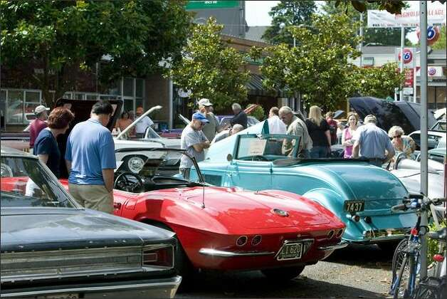 Two blocks of classic cars attracted a crowd at the Magnolia Village Auto Show on West McGraw Street Saturday. Photo: Grant M. Haller, Seattle Post-Intelligencer