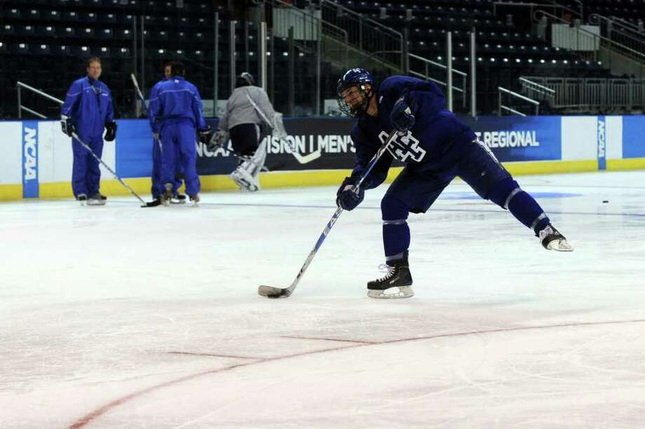 Members of the Air Force hockey team practice for the NCAA tournament at Webster Bank Arena at Harbor Yard on March 24, 2011. Photo: Lindsay Niegelberg / Connecticut Post