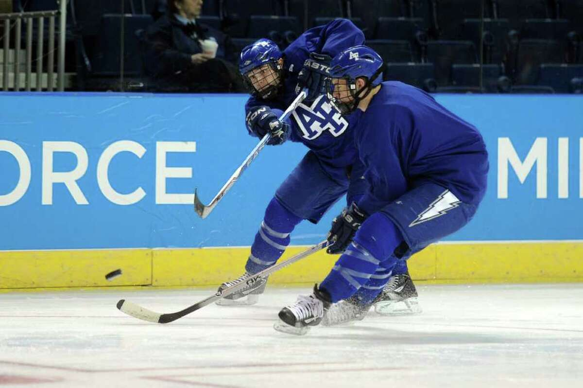 Members of the Air Force hockey team practice for the NCAA tournament at Webster Bank Arena at Harbor Yard on March 24, 2011.