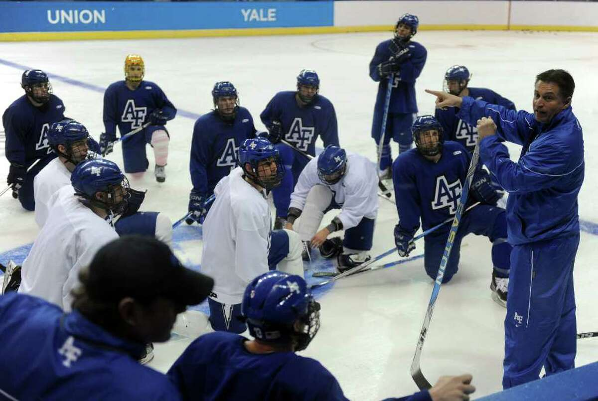 Air Force hockey coach Frank Serratore talks to his team during practice for the NCAA tournament at Webster Bank Arena at Harbor Yard on March 24, 2011.