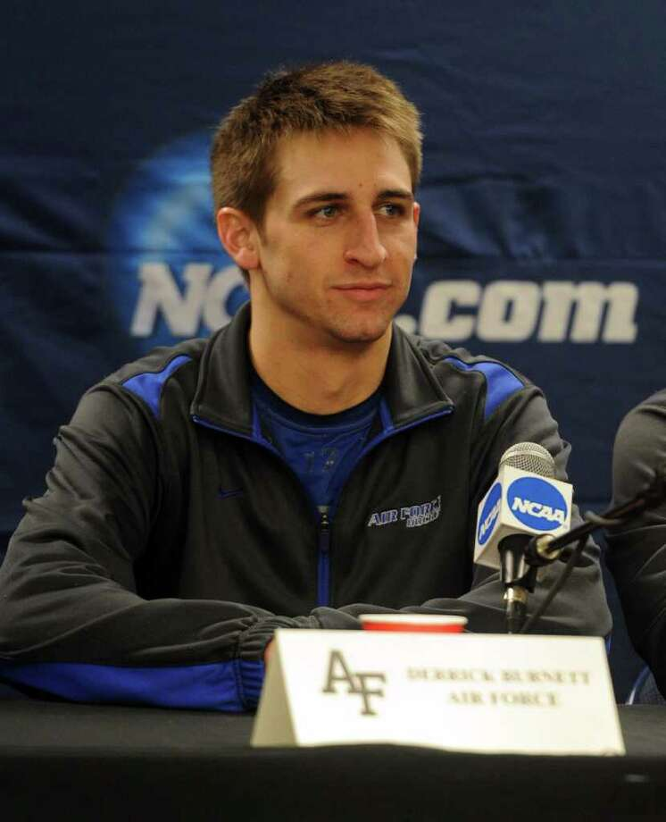 Air Force hockey team member Derrick Burnett speaks at the press conference after practice for the NCAA tournament at Webster Bank Arena at Harbor Yard on March 24, 2011. Photo: Lindsay Niegelberg / Connecticut Post