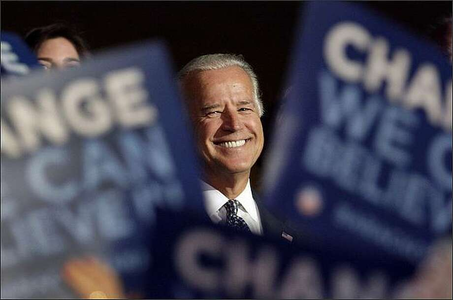 Democratic vice presidential candidate, Sen. Joe Biden, D-Del., smiles after arriving at the Pepsi Center for the Democratic National Convention in Denver. (AP Photo/Ron Edmonds)