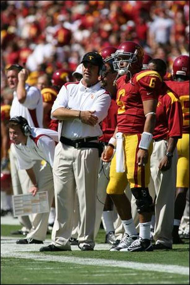 Steve Sarkisian, with USC quarterback Mark Sanchez, has Huskies boosters excited. Photo: Jeff Golden/Getty Images