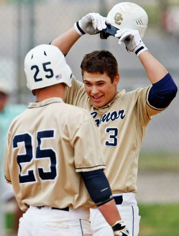 O'Connor's Landon Thompson (right) — seen here getting kudos from teammate Billy Craft after a home run in a March victory against Warren — was one of five area players named to first-team All-State by the Texas High School Baseball Coaches Association. Thompson, who batted .522 with 12 home runs, was the only area player on the Class 5A first team. Photo by Marvin Pfeiffer Photo: Marvin Pfeiffer/Prime Time Newspapers