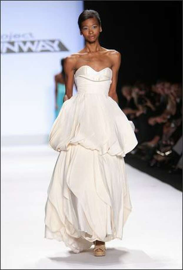 A model walks the runway wearing a dress designed by Leanne Marshall. Photo: Getty Images