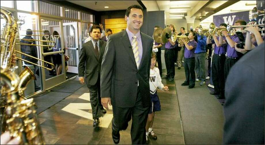 Steve Sarkisian, the Huskies' new head football coach enters the Don James Center at the University of Washington for the news conference where he was officially introduced in Seattle on Monday. Sarkisian will leave USC where he was assistant head coach and offensive coordinator. Photo: Dan DeLong/Seattle Post-Intelligencer