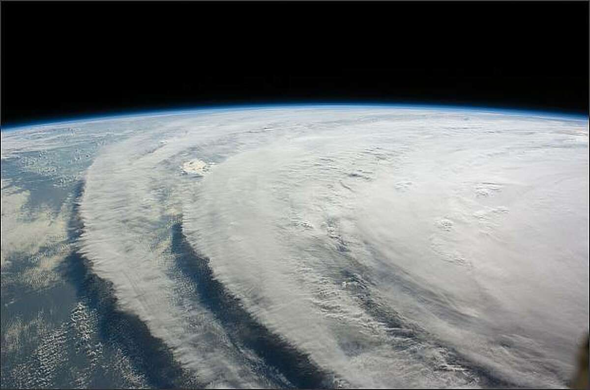 This image provided by NASA shows Hurricane Ike in the Gulf of Mexico closing in on the Texas coast. The image was taken Wednesday Sept. 10, 2008 from the International Space Station. At 5 a.m. EDT Friday, the storm was centered about 265 miles southeast of Galveston, moving to the west-northwest near 13 mph. Ike was a Category 2 storm with maximum sustained winds that had increased slightly to near 105 mph. (AP Photo/NASA)