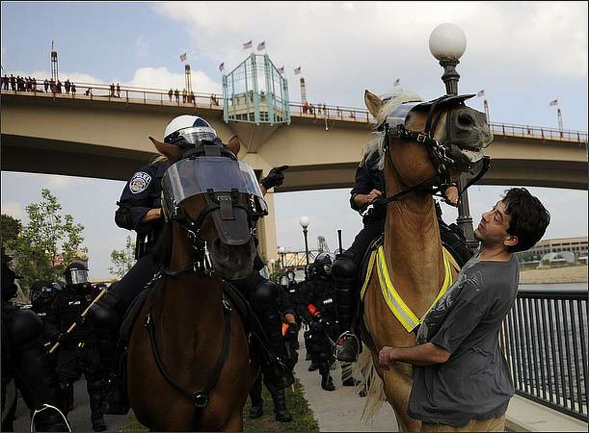 A police horse runs into a man, as police patrol and detain people near the Xcel Center, the site of the 2008 Republican National Convention (in St. Paul, Minnesota. Eric Thayer/Getty Images