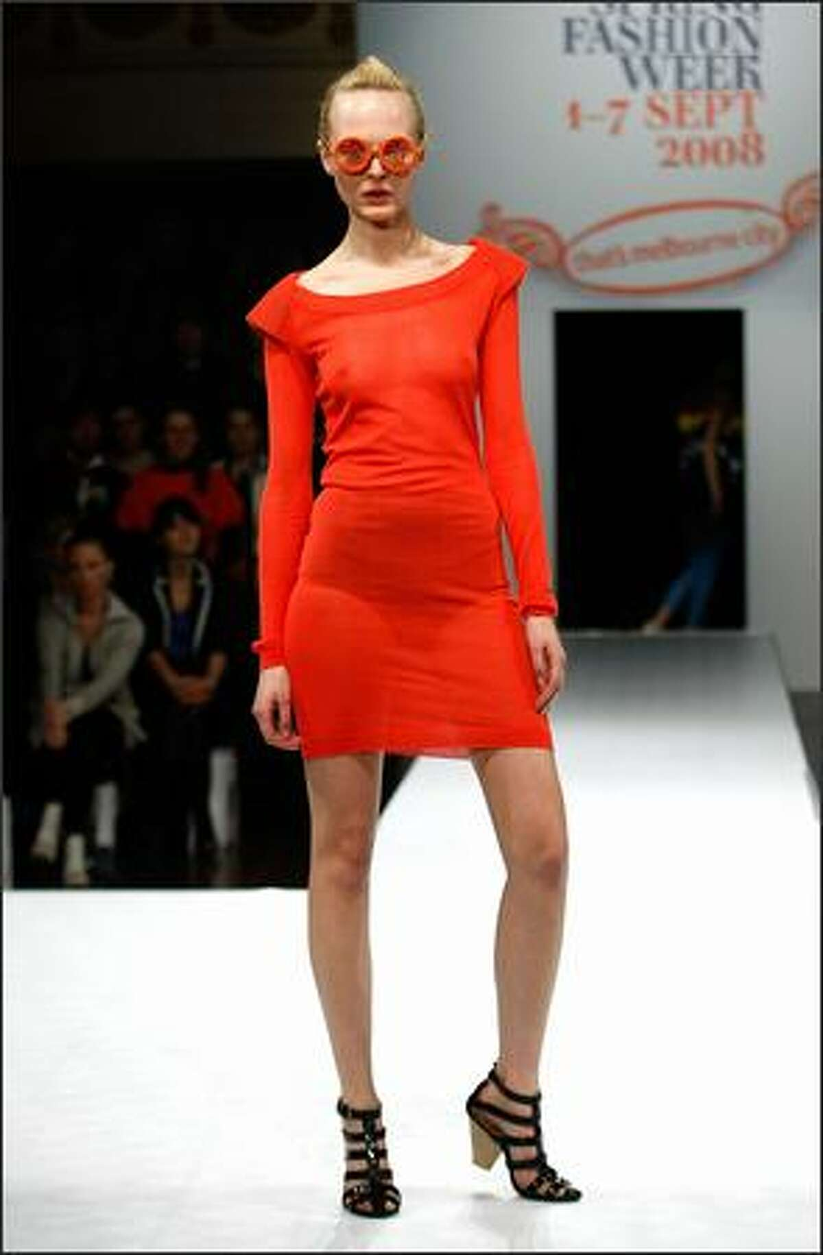 A model showcases designs by TV as part of the Out of The Shadows catwalk show on the second day of Melbourne Spring Fashion Week 2008, at Melbourne Town Hall on Wednesday in Melbourne, Australia.