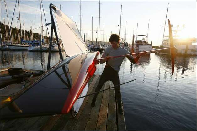 Matt Pistay attaches the foils to his moth boat at Shilshole Bay Marina. With less water resistance, hydrofoil moths travel faster than sailboats. The record is 27 knots. Photo: Joshua Trujillo/Seattle Post-Intelligencer