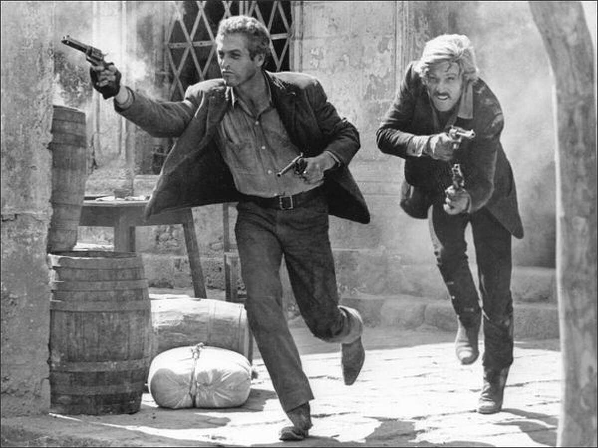 In this 1969 file photo, actors Paul Newman, left, as Butch Cassidy, and Robert Redford, as the Sundance Kid, appear in the final shootout scene in the film
