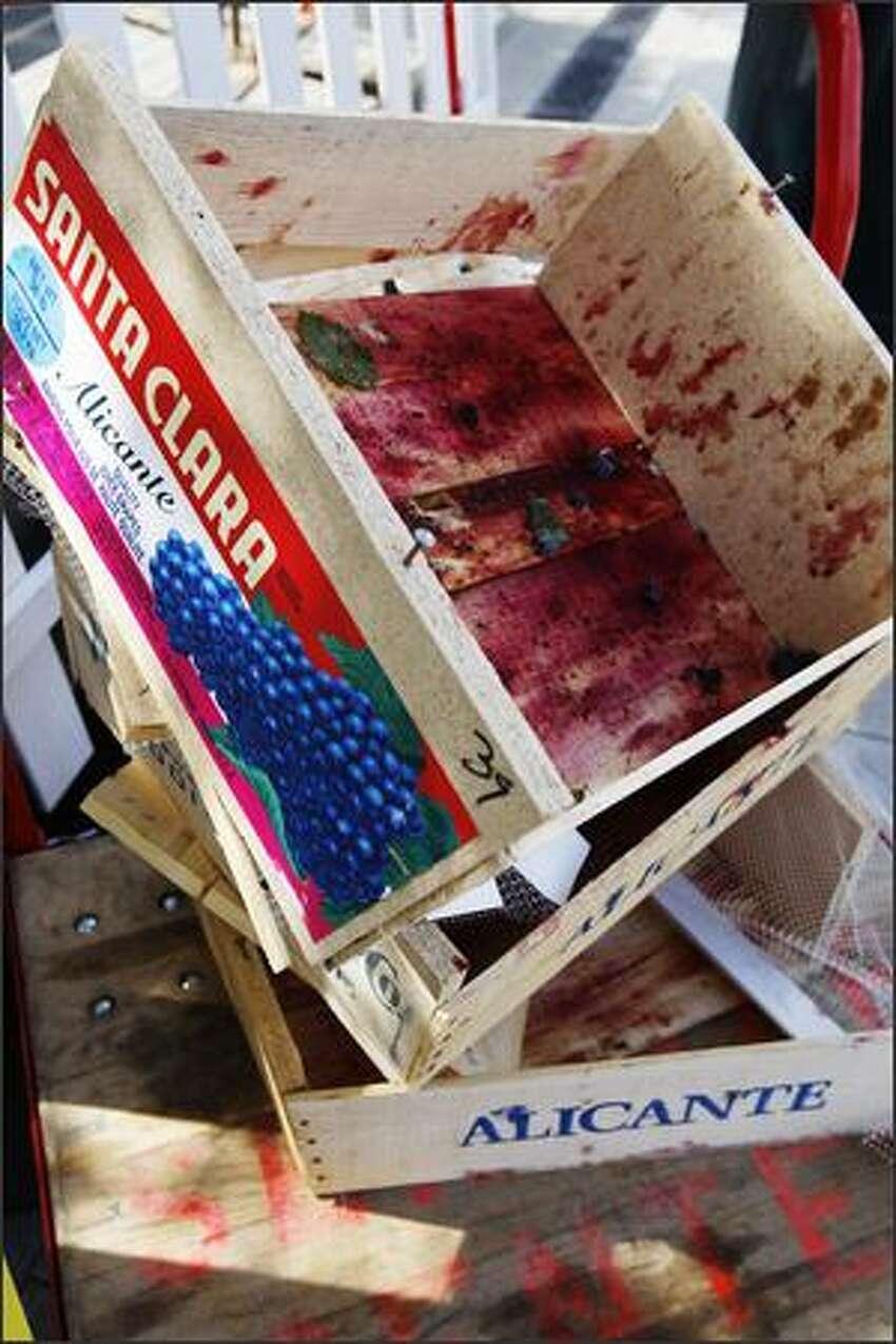 Empty grape crates are seen at Saturday's Festa Italiana (Italian Festival) at Seattle Center.