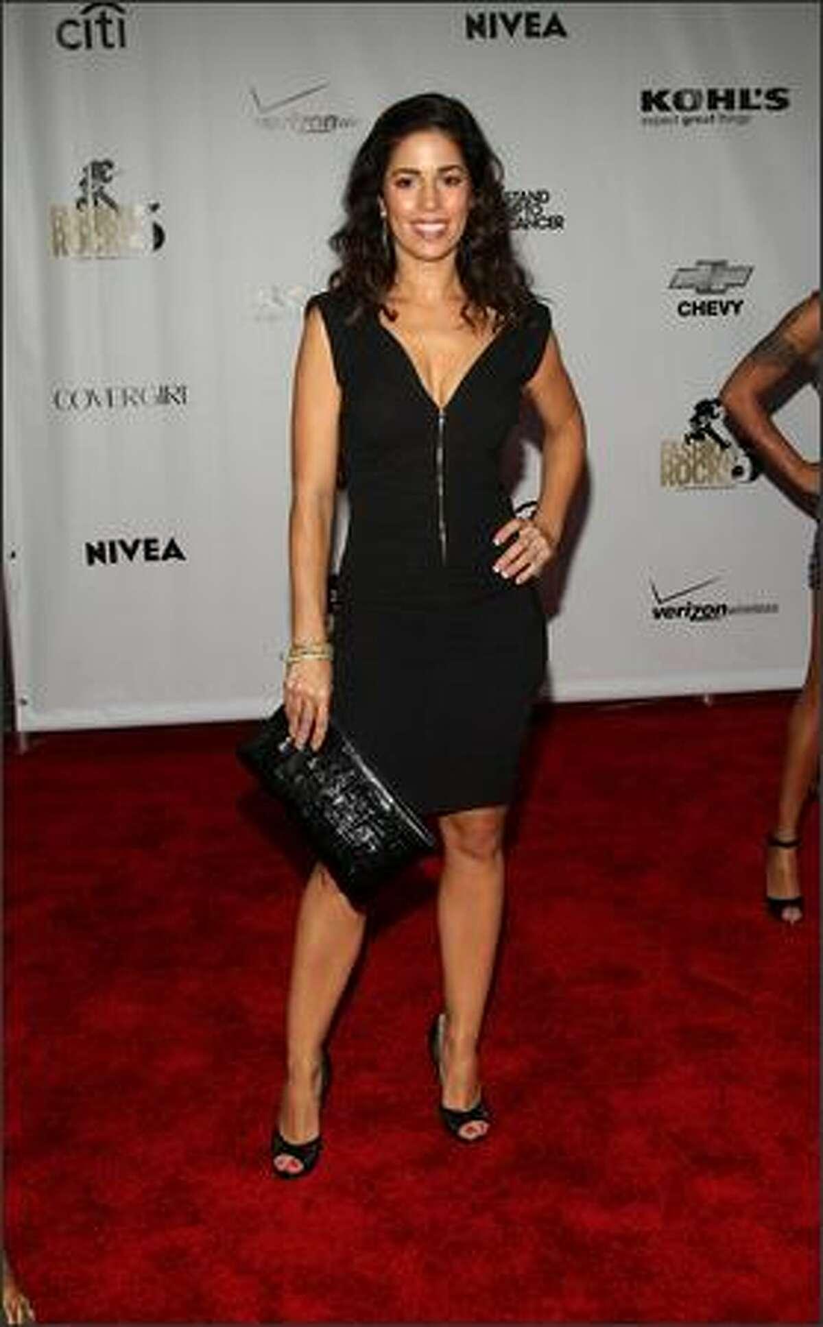 Actress Ana Ortiz arrives.