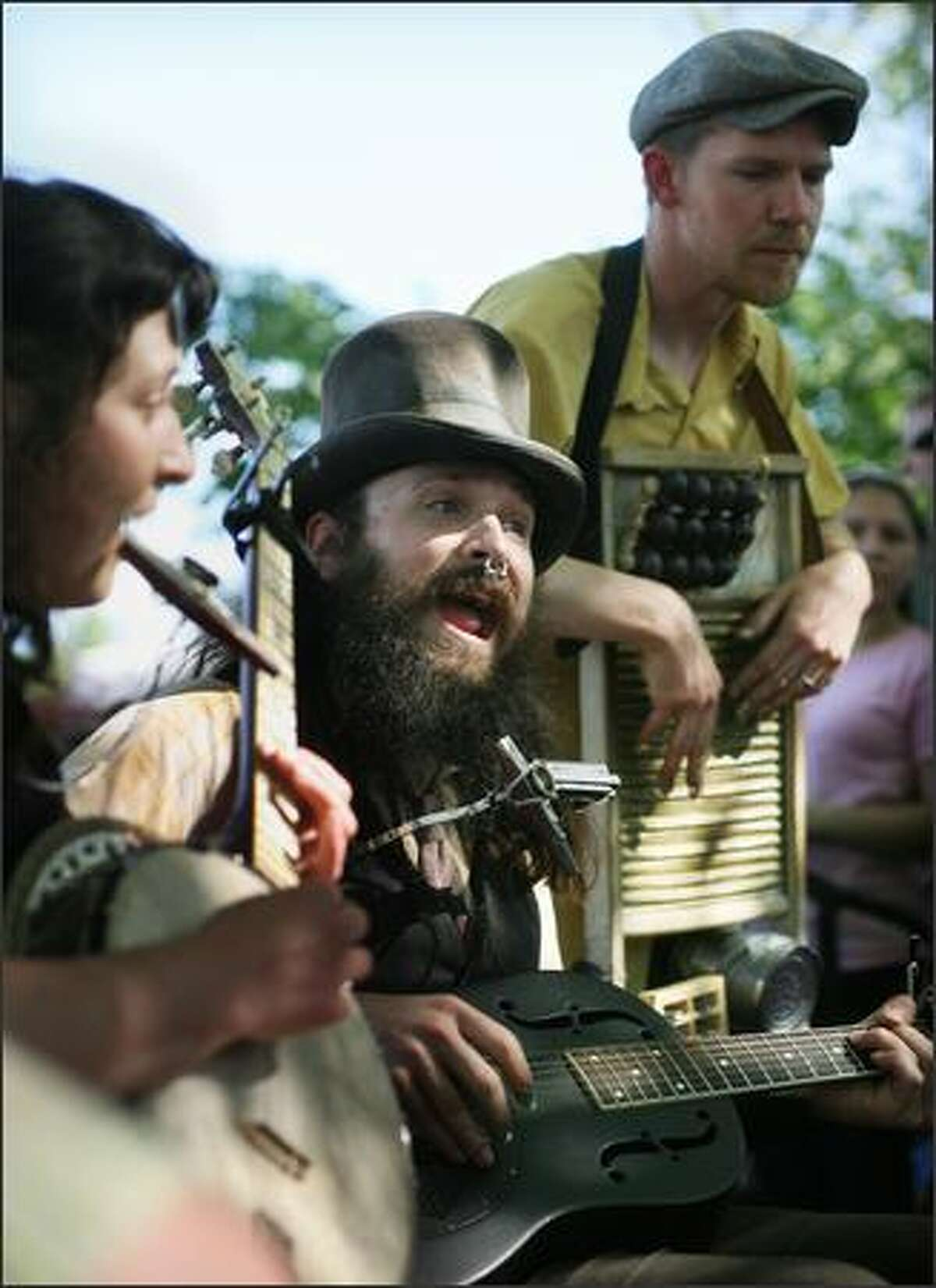Kit Stymee Stovepipe sings with the Port Townsend band Crow Quill Night Owls during the Northwest Folklife Festival at the Seattle Center on Saturday.